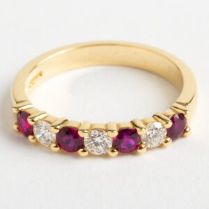 1/2 eternity ring with rubies and diamonds