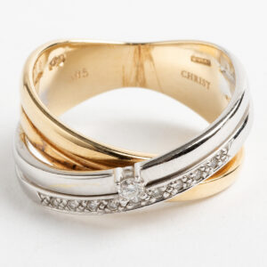 Crossover band pave set diamond ring